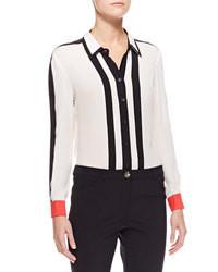 Blusa de botones de rayas verticales en blanco y negro