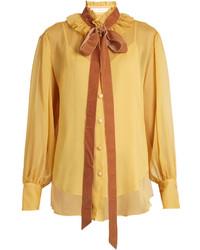 Blusa de botones mostaza