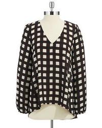 Blusa de manga larga a cuadros en negro y blanco