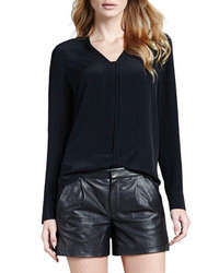 Blusa de manga larga de seda negra
