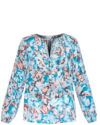 Blusa de manga larga estampada en blanco y azul