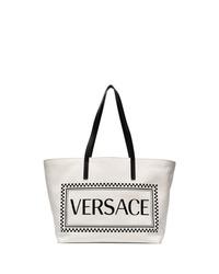 Bolsa tote de lona estampada en blanco y negro de Versace