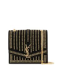 Bolso bandolera de cuero con tachuelas en negro y dorado de Saint Laurent