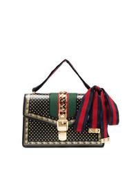 Bolso bandolera de cuero estampado negro de Gucci