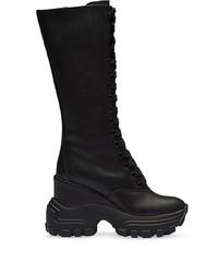 Botas a media pierna de cuero gruesas negras de Miu Miu