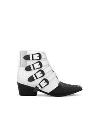 Botas camperas de cuero en blanco y negro