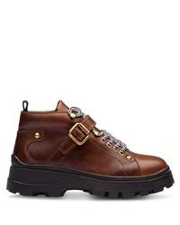Botas planas con cordones de cuero gruesas marrónes de Miu Miu