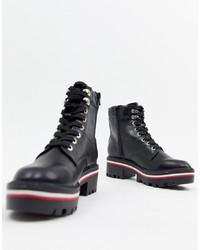 Botas planas con cordones de cuero gruesas negras