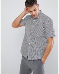 Camisa de manga corta de rayas verticales en blanco y negro