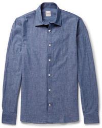 Un abrigo largo azul marino y una camisa de manga larga son una gran fórmula de vestimenta para tener en tu clóset.