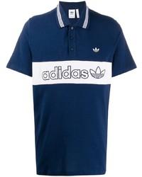 Camisa polo en azul marino y blanco de adidas
