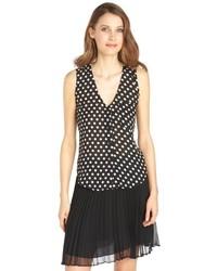 Camisa sin mangas a lunares en negro y blanco