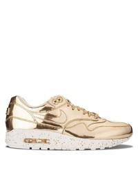 Deportivas de cuero doradas de Nike