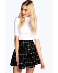 f25823cb68 Cómo combinar una falda skater a cuadros en negro y blanco (3 looks ...