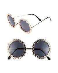 Gafas de sol con adornos en negro y dorado