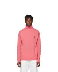 Jersey de cuello alto de lana rosado