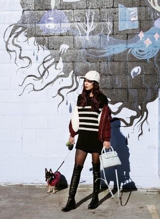 Cómo combinar: bolso bandolera de cuero celeste, botas sobre la rodilla de cuero negras, vestido jersey de rayas horizontales en negro y blanco, cazadora de aviador burdeos