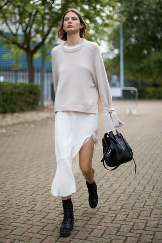 mejor venta varios estilos completamente elegante Un jersey con cuello circular de vestir con un vestido midi blanco ...