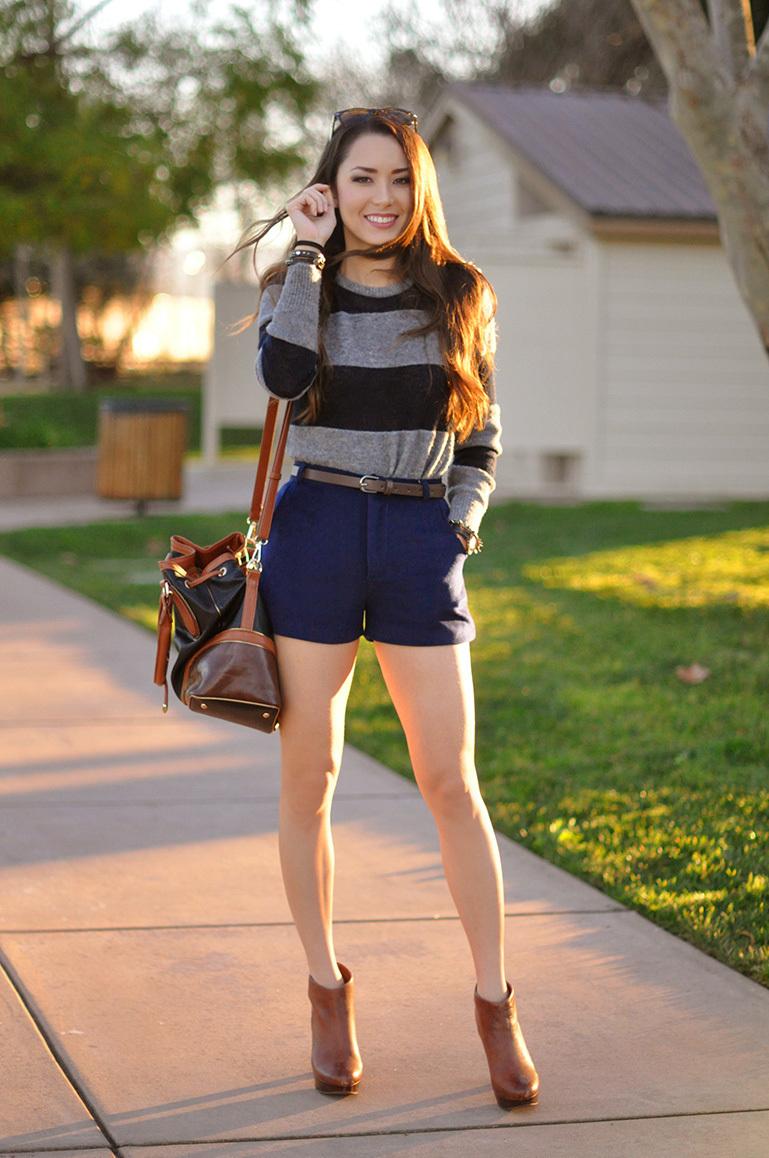 f7da641c8 Cómo combinar unos pantalones cortos azul marino con unas botas marrónes (8  looks de moda)