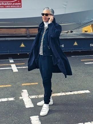 Combinar una chaqueta estilo camisa azul marino: Intenta ponerse una chaqueta estilo camisa azul marino y un pantalón de chándal azul marino para cualquier sorpresa que haya en el día. Tenis de lona blancos son una opción atractiva para complementar tu atuendo.