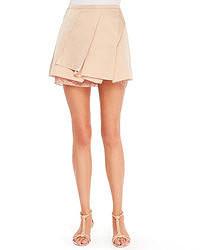 Minifalda plisada en beige