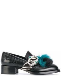 Mocasín con borlas de cuero negro de Prada