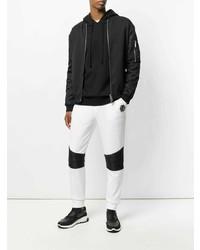 e92dc1fbcc Comprar un pantalón de chándal en blanco y negro  elegir pantalones ...
