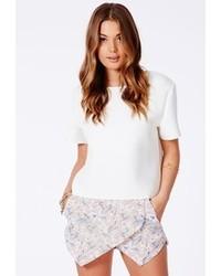 Pantalones cortos con print de flores en beige