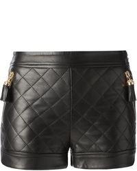 Pantalones cortos de cuero acolchados negros