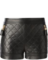 Pantalones cortos de cuero acolchados negros de Moschino