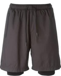 Pantalones cortos en gris oscuro de Puma