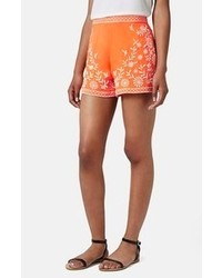 Pantalones cortos estampados naranjas