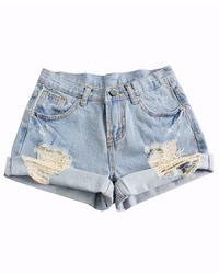 Pantalones cortos vaqueros desgastados