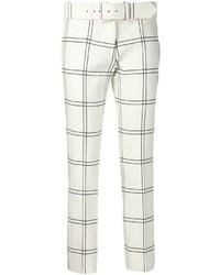 Pantalones pitillo a cuadros en blanco y negro
