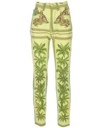 Pantalones pitillo con estampado geométrico verdes de Versace
