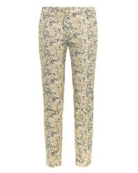 Pantalones pitillo con print de flores en beige