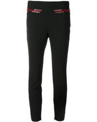 Pantalones pitillo de encaje negros de Alexander McQueen