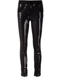 Pantalones pitillo de lentejuelas negros de Vera Wang