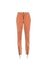 Pantalones pitillo naranjas de Andrea Bogosian