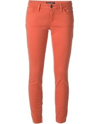 Pantalones pitillo naranjas de Dolce & Gabbana