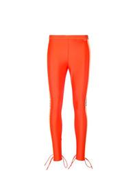 Pantalones pitillo naranjas de Fenty X Puma