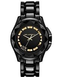 Reloj en negro y dorado
