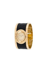 Reloj en negro y dorado de Gucci