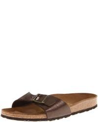 Sandalias planas de cuero en marrón oscuro de Birkenstock