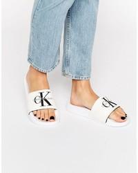 Sandalias planas de lona blancas