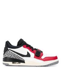 Tenis de cuero en blanco y rojo de Nike