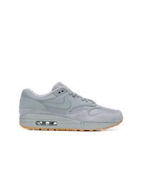 Tenis de cuero grises de Nike