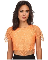 Top corto naranja original 3990000