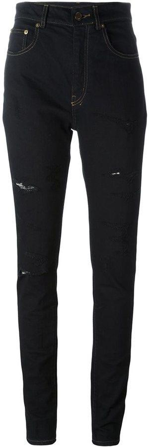 Vaqueros pitillo de algodón desgastados negros de Saint Laurent