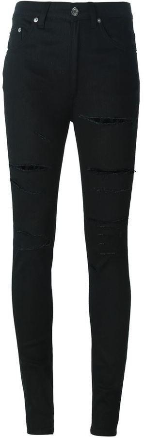 Vaqueros pitillo desgastados negros de Saint Laurent